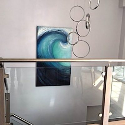 """Commission of """"Into the blue"""" a large wave painting in situ in the stairwell."""